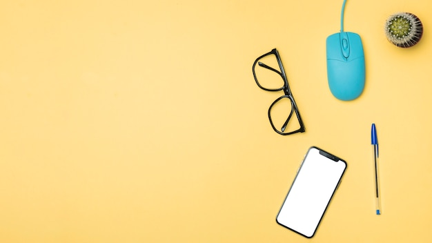 Flat lay desk concept with yellow background Free Photo