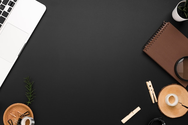Flat lay of desktop with copy space and desk essentials Free Photo
