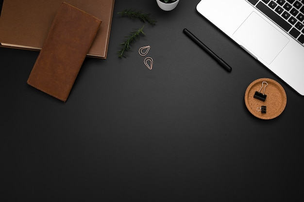 Flat lay of desktop with laptop and copy space Free Photo