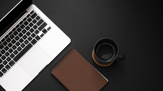 Flat lay of desktop with laptop and cup of coffee Free Photo