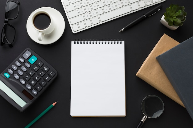 Flat lay of desktop with notebook and agendas Free Photo