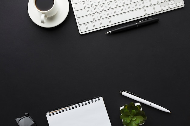 Flat lay of desktop with notebook and coffee cup Free Photo