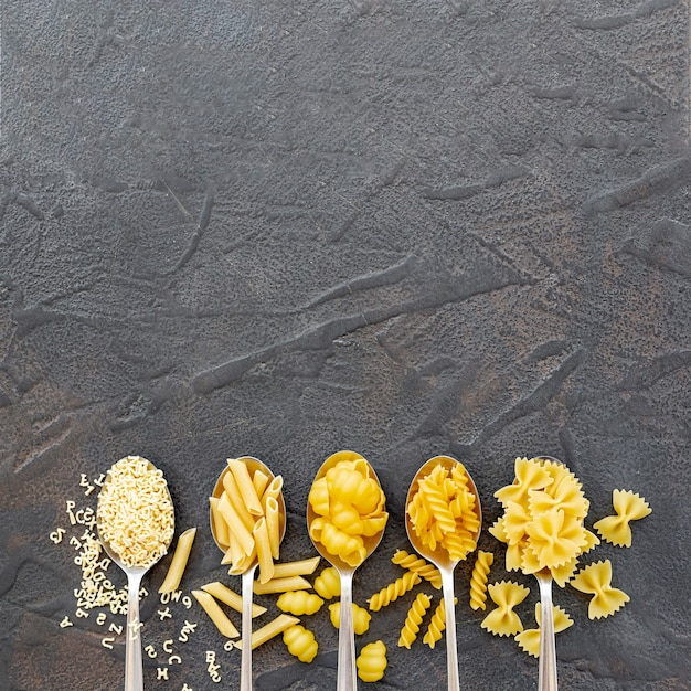 Flat lay of different types of pasta with copy space Free Photo