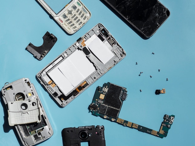 Flat lay of disassembled phone parts Free Photo