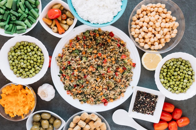Flat lay of dishes with chickpeas and black pepper Free Photo