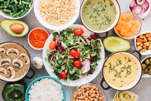Flat lay of dishes with salad and soups Free Photo