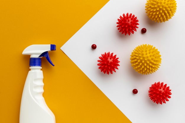 Flat lay of disinfectant bottle and viruses Free Photo