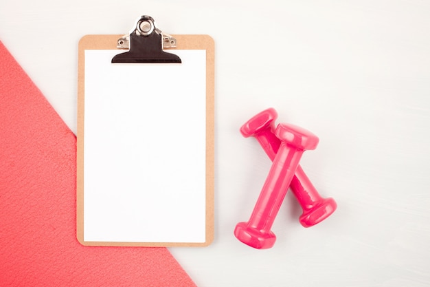 Flat lay of dumbbell, sport and fitness equipments Premium Photo