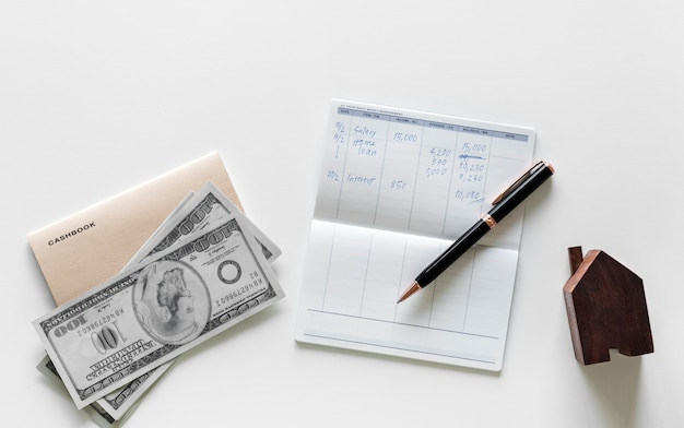 Flat lay of earning money concept Free Photo