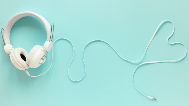 Flat lay of earphones on plain background Free Photo