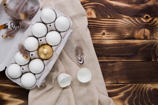 Flat lay of easter eggs in carton with copy space Free Photo
