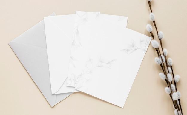 Flat lay elegant wedding invitations on table Free Photo