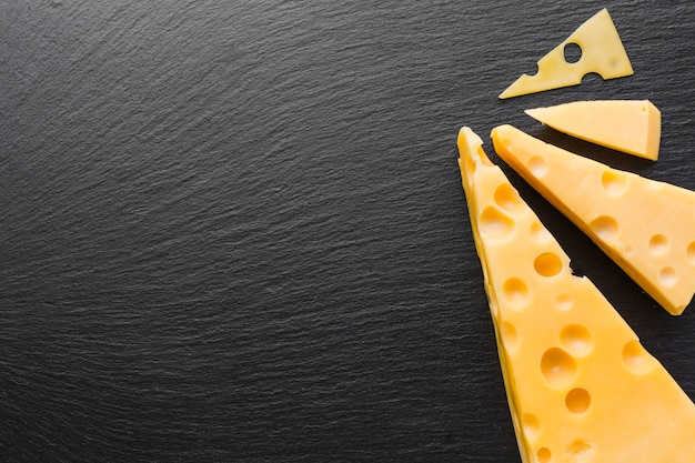 Flat lay emmental cheese with copy space Free Photo