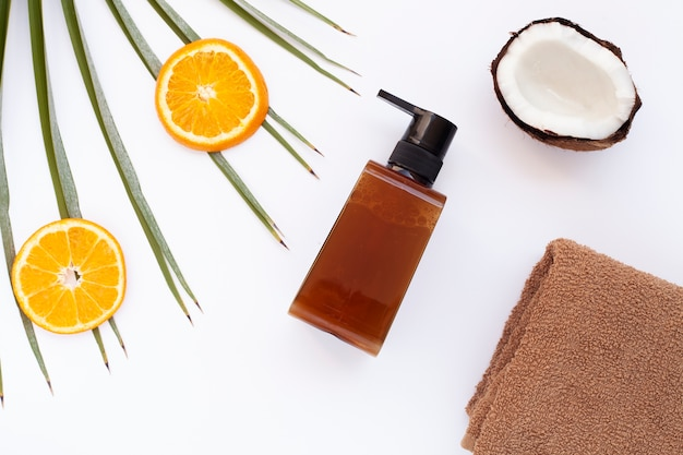 Flat lay of essential oil and coconut on white background Free Photo