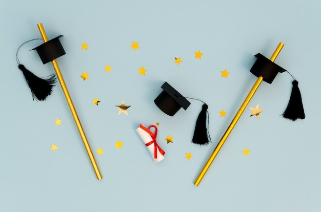 Flat lay festive graduation arrangement on blue background Premium Photo