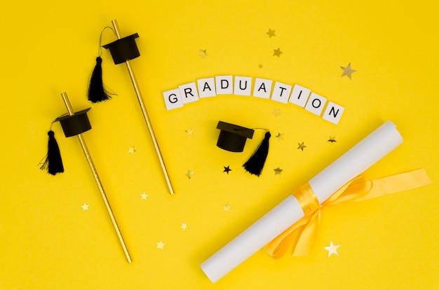 Flat lay festive graduation arrangement with text on white cubes Premium Photo