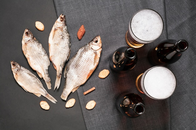 Flat lay fish with beer bottles and glasses Free Photo