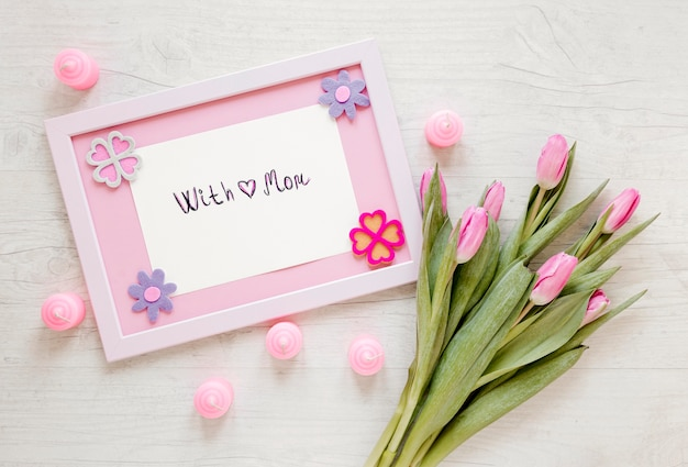Flat lay flowers and frame arrangement Free Photo