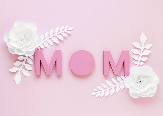Flat lay flowers on pink background Free Photo