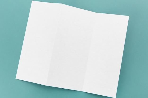 Flat lay folded white brochure Free Photo