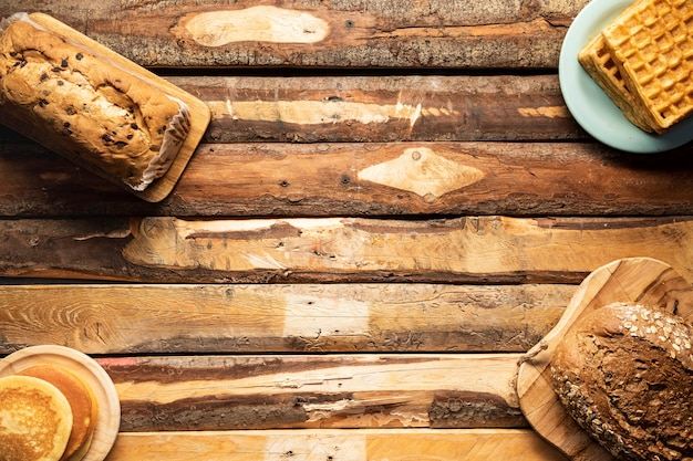 Flat lay food arrangement on wooden table Free Photo