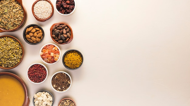 Flat lay food frame with seeds and soup Free Photo
