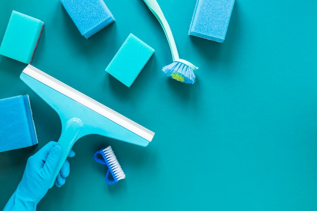Flat lay frame with blue cleaning products Free Photo