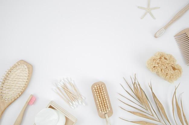 Flat lay frame with brushes on white background Free Photo