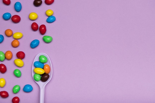 Flat lay frame with candy and spoon Free Photo