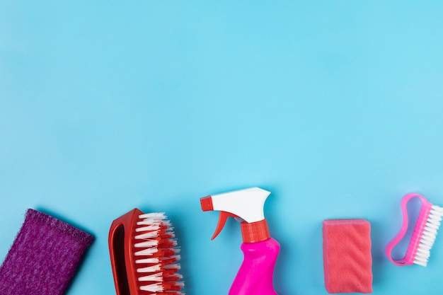 Flat lay frame with different cleaning items Free Photo
