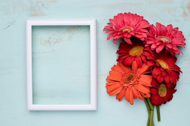 Flat lay of frame with floral concept Free Photo