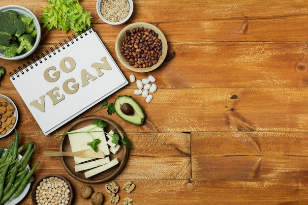 Flat lay frame with healthy food on wooden background Free Photo