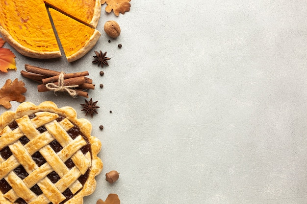 Flat lay frame with sliced pumpkin pie and acorn Free Photo