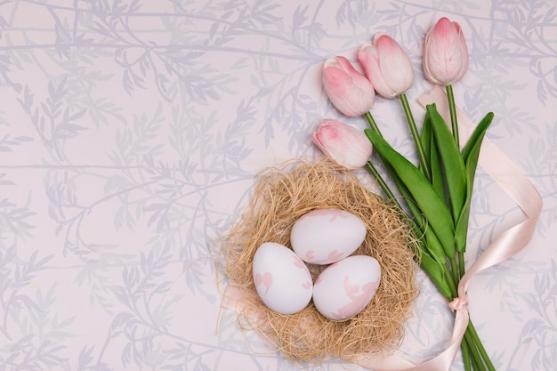Flat lay frame with tulips and eggs Free Photo