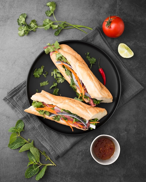 Flat lay of fresh sandwiches on plate with sauce Free Photo