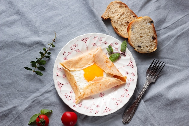 Flat lay fried eggs with crepes Free Photo