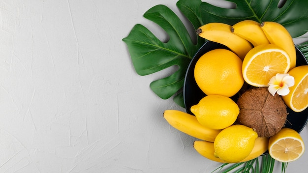 Flat lay of fruits in bowl with copy space Free Photo