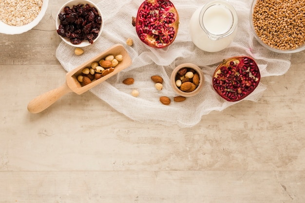 Flat lay fruits nuts and oats with copy space Free Photo
