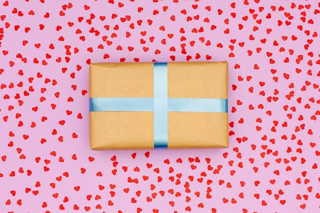 Flat lay gift box on pink background Free Photo