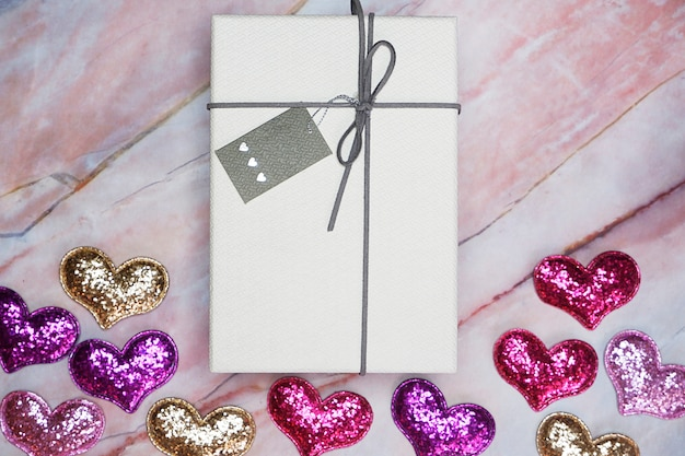 Flat-lay gift box on table for valentine background Premium Photo