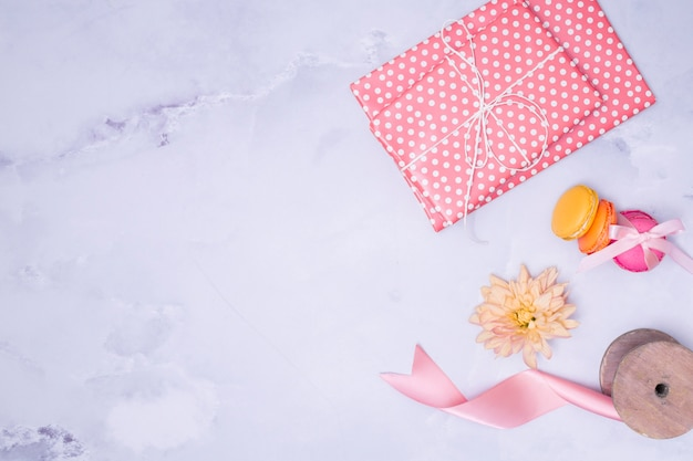 Flat lay girly birthday supplies on marble background Free Photo