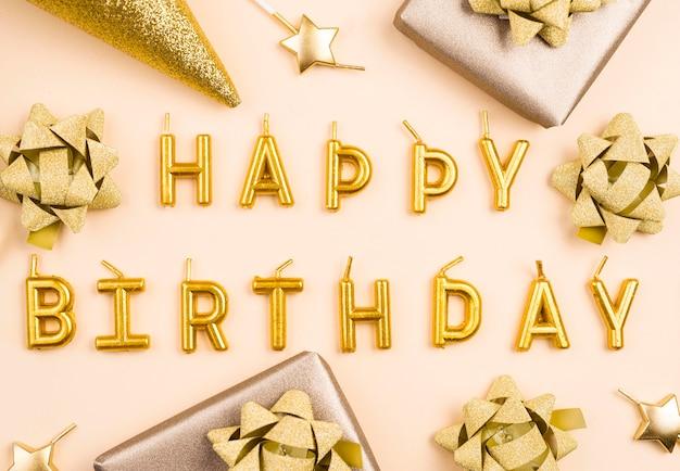 Flat lay golden birthday decorations Premium Photo