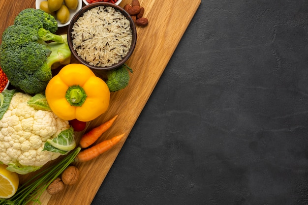 Flat lay of groceries on cutting board Free Photo