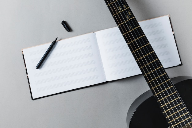 Flat lay of guitar and music notes Free Photo