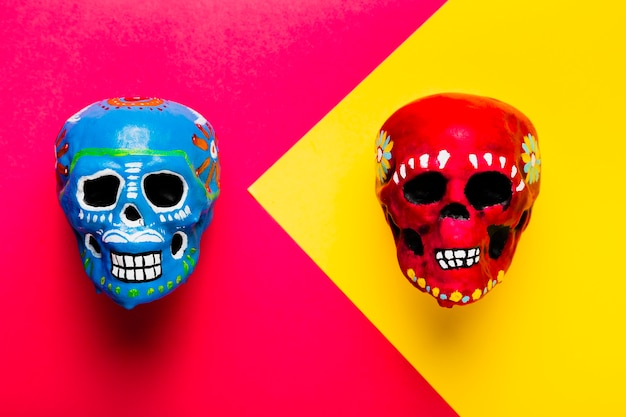 Flat lay halloween decoration with colourful skulls Free Photo