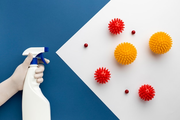 Flat lay of hand holding disinfectant against viruses Free Photo