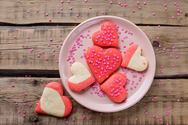 Flat lay of heart-shaped cookies on plate Free Photo
