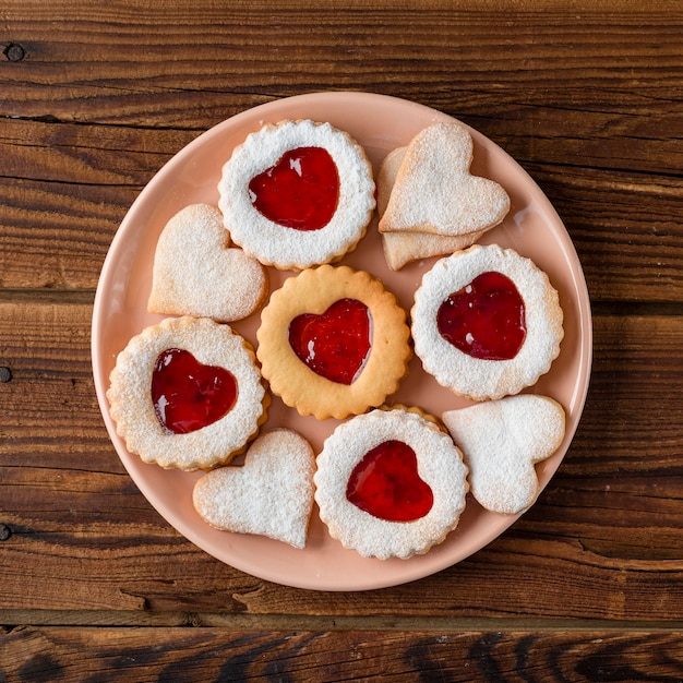 Flat lay of heart-shaped cookies with jam Free Photo
