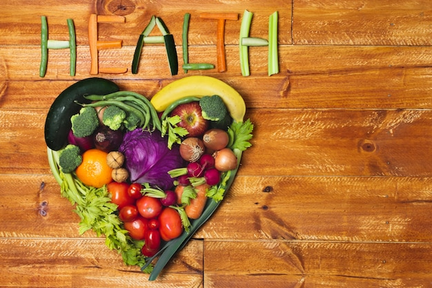 Flat lay heart shaped vegetable arrangement Free Photo