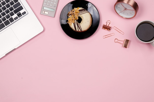 Flat lay home office desk workspace on pink background. top view. Premium Photo